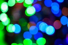Bokeh vert et bleu de Noël de lumières de couleur Image libre de droits