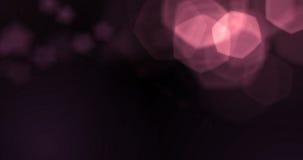 Bokeh violeta púrpura abstracto de las partículas de las burbujas de la chispa del brillo en el fondo negro, día de fiesta festiv Fotografía de archivo libre de regalías