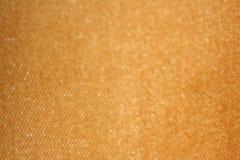 Bokeh vom goldenen Gewebe stockfoto