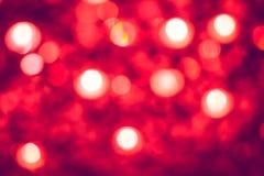 Bokeh von roten Lichtern in der Feier Stockbilder