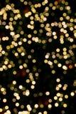 Bokeh-Weihnachtsbaumhintergrund Stockfotos