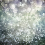 Bokeh winter Christmas holiday background. Festive winter  abstract nature background with  bokeh lights and stars Royalty Free Stock Photo