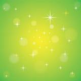 Bokeh y estrellas chispeantes en un fondo de color verde amarillo Fotos de archivo libres de regalías