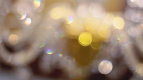 Bokeh. Yellow, blurred, bokeh lights background. Abstract sparkles stock video