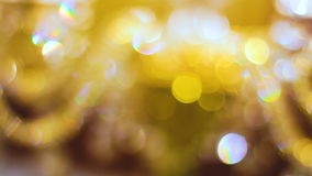 Bokeh. Yellow, blurred, bokeh lights background. Abstract sparkles stock video footage