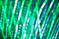 Bokeh zaświeca, migocący plama punktu światła na zielonym abstrakcjonistycznym tle Obrazy Royalty Free