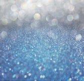 蓝色和灰色抽象bokeh光。defocused bac 免版税库存照片