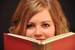 boken avmaskar Arkivfoto