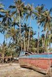 Boken fishing boat. Broken fishing boat and palm trees Myanmar Stock Images