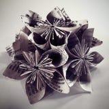 Boken söker upp handgjord origami tätt Royaltyfria Bilder