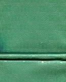 Bokomslag med präglade motiv arkivfoto