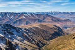Bokong Nature Reserve Mountains. Snow-capped mountain peaks as viewed from the Bokong Nature Reserve Visitors` Center in Leribe, Lesotho near the Mafika Lisiu stock photos