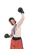 Bokser jest ubranym złotego medalu spełniania bokserską postawę fotografia stock