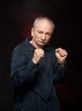 boksera starszych osob mężczyzna poza Obrazy Royalty Free