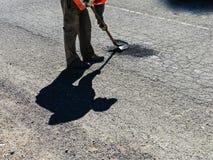 Bokslutgropar med asfalt Arkivbild