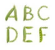 Bokstäver av det engelska alfabetet med gröna ärtor, abc Royaltyfria Foton