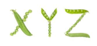 Bokstäver av det engelska alfabetet med gröna ärtor, abc Royaltyfri Foto