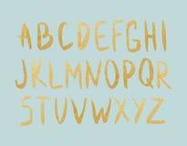 Bokstäver för guld- folie för vektor på mintkaramellbakgrund Royaltyfri Bild