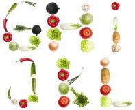 bokstäver gjorde grönsaker Arkivbild