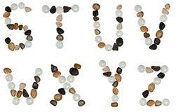 bokstäver gjorde stenar Arkivfoton