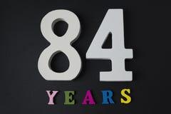 Bokstäver och nummer åttioåfyra på en svart bakgrund Fotografering för Bildbyråer