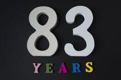 Bokstäver och nummer åttiotre gamla år på en svart bakgrund Royaltyfri Foto
