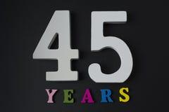 Bokstäver och nummer fyrtiofem år på en svart bakgrund Royaltyfri Foto