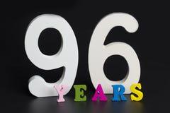 Bokstäver och nummer nittiosex år på en svart bakgrund Royaltyfri Foto