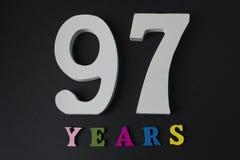 Bokstäver och nummer nittiosju år på en svart bakgrund Royaltyfri Bild