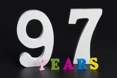 Bokstäver och nummer nittiosju år på en svart bakgrund Royaltyfria Foton