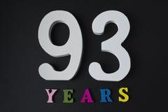 Bokstäver och nummer nittiotre gamla år på en svart bakgrund Royaltyfri Bild