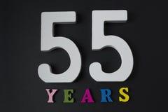 Bokstäver och nummer till femtiofem på den svarta bakgrunden Fotografering för Bildbyråer
