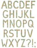 Bokstäver och symboler för engelskt alfabet som göras av små godisar Royaltyfria Foton