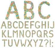 Bokstäver och symboler för engelskt alfabet som göras av små godisar Royaltyfri Foto