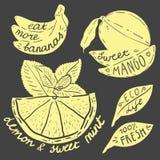 Bokstäver på frukter och grönsaker Royaltyfria Foton