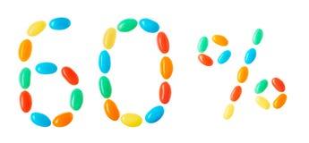 60% bokstäver som göras av isolerade mångfärgade godisar på vit Royaltyfri Fotografi