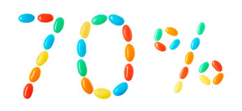 70% bokstäver som göras av isolerade mångfärgade godisar på vit Arkivbilder