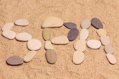 Bokstäver SPA på sanden Royaltyfria Foton
