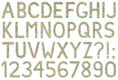 Bokstäver, tal och symboler för engelskt alfabet som göras av liten ca Fotografering för Bildbyråer