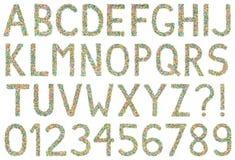 Bokstäver, tal och symboler för engelskt alfabet som göras av liten ca Royaltyfria Foton