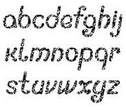 Bokstäverna av det engelska alfabetet som består av talrika svarta fjärilar Royaltyfri Foto