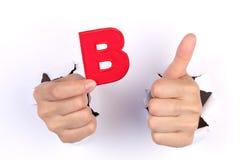 Bokstav B med tummen upp tecken Royaltyfri Foto