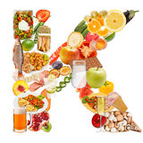 Bokstav K som göras av mat Arkivbild