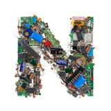 Bokstav N som göras av elektroniska delar Arkivbild