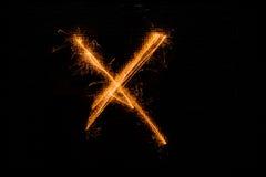 Bokstav X som göras av tomtebloss på svart Royaltyfria Foton