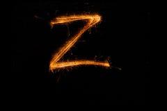 Bokstav Z som göras av tomtebloss på svart Royaltyfria Foton