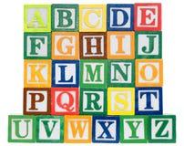 Bokstaven blockerar att stava som är dess en pojke Arkivbilder