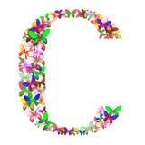 Bokstaven C utgjorde av massor av fjärilar av olika färger Royaltyfri Foto