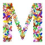 Bokstaven M utgjorde av massor av fjärilar av olika färger Arkivfoto