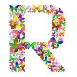 Bokstaven R utgjorde av massor av fjärilar av olika färger Fotografering för Bildbyråer